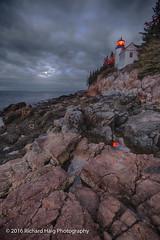 Bass Harbor Head Lighthouse under a full moon before sunrise (RichHaig) Tags: lighthouse landscape nikonnikkor1424mmf28 acadianationalpark me mdi richhaig maine gitzotripod rocks bassharbor atlanticocean bassharborheadlighthouse clouds reflection water barharbor nikond800 fullmoon longexposure nationalpark