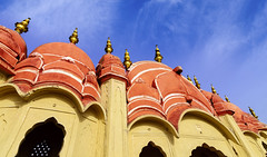 Hawa Mahal Palace (Palace of Winds), famous landmark of Jaipur (KS Photography!) Tags: hawamahal havamahal windpalace palaceofwinds breeze palace sandstone historic architecture rajputarchitecture famous attraction history landmark structure crownofkrishna hindugod fivestorey exterior windows jharokha latticework interior pyramidal shape monument dome finials colors colorful red pink decor colour pinkcity heritage architecturalheritage hindurajput islamic mughal facade vintage outdoor building clouds jaipur rajasthan india lowangle