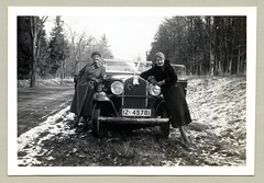 Opel 1,8 Liter Cabriolet (Raymondx1) Tags: vintage classic black white blackwhite sw photo foto photography automobile car cars motor opel opel18liter cabriolet convertible lady girl ladies 1930s thirties fashion coat woolencoat silkstockings gloves horseshoe stuffedtoy cuddlytoy hare bunny luckycharm vehicle antique auto