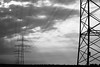 Power line (Elios.k) Tags: camera travel light sky blackandwhite bw sunlight travelling tower tourism nature monochrome weather silhouette horizontal clouds canon germany outdoors photography wire energy ray power cloudy pair perspective august cable nopeople structure line pylon aachen electricity powerline transmission lattice escaping 2015 northrhinewestphalia kohlscheid 5dmkii