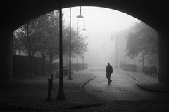Castlefield in the fog (Sandy Sharples) Tags: street bridge november autumn trees shadow blackandwhite mist man monochrome fog arch cobble castlefield