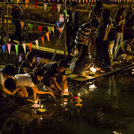 Thai people setting their candle-lit krathongs in the Ping river at night during Loy Krathong 2015-134 thumbnail