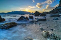 Peaking Sun (landscapist) Tags: mountain seascape beach nature sunrise landscape island twilight rocks capones