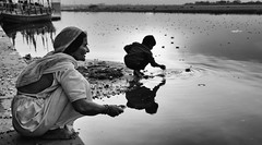 Yamuna Ghats (Padmanabhan Rangarajan) Tags: holi yamuna india old woman boy lamps river praying hindu tradition mathura vrindavan