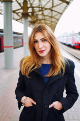E (alexrgb5) Tags: portrait woman trainstation autumn cold day outdoor