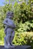 In the backyard: Peeing boy statue (bbarekas) Tags: statue boy peeing water marble white grey green trees background 50mm dof bokeh backyard august megalopolis arcadia greece