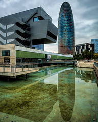 Torre Agbar (p_velden) Tags: spain barcelona catalunya es torre agbar tower water reflection glass office clouds contrast
