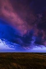 Howling Whispers (J Swanstrom (Check out my albums)) Tags: cloud sky color pink purple blue prairie southdakota jswanstromphotography nikon d750 field landscape susset evening pasture weather storm falsecolor clouds
