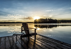 I wish to be there (mystero233) Tags: canada ontario muskoka lake chair dock water sunrise sun reflection island trees sky blue fog calm outdoor north america relax