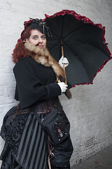 WHITBY GOTH WEEKEND BY PAT LYTTLE (jpassionpat) Tags: umbrella fur mink headdress spider jacket blackdress corset bag gloves