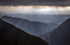 Divine Grace ( Explored) (Sapna Reddy Photography) Tags: cherrapunji sohra meghalaya india northeastindia mountains sunrise outdoor nature blue dawn morning sunbeams sunrays mountainside valleys clouds