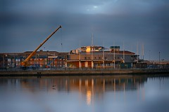 Blurred reflections : ) (Andrew Laws) Tags: construction building crane nikon d7100 50mm f18 reflections sea lake house houses lowlight dark sunset night glow hdr edit edited demolish bird cormorant