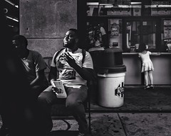 Taste of Cigarellos and water ice (c. Melon Images) Tags: street city light shadow summer urban bw white man black philadelphia girl mono fuji cigar scene story philly waterice cigarillo