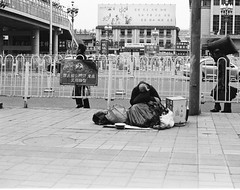 "Shrinking (Xsbmrnr (Please read profile before ""following"") Tags: poverty china street blackandwhite film 35mm beijing streetphotography bandw om1 olympusom1 chinaimages chinesestreetshots"