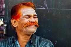 Indian Man Smiling With Red Hair (AdamCohn) Tags: orange india hairdye smile laugh maharashtra mustache redhair nashik adamcohn wwwadamcohncom