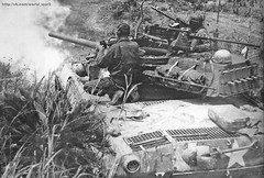 """American M18 tank destroyer """"Hellcat"""" firing on fortified positions, the Japanese Shuri line."""