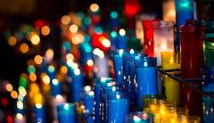 Iluzsin (debjean31) Tags: barcelona blue light red luz church yellow azul dark navidad rojo candle bokeh iglesia amarillo vela   oscuridad cristmas       kurisumasu   juegolvm
