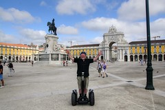 Segway Tour (Tony Shertila) Tags: 20160817103708 chiado geo:lat=3870726420 geo:lon=913595796 geotagged lisboa portugal prt europe weather day partlycloudy praadocomrcio sky segway arch construction city square transport tram sculpture josi outdoor