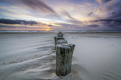 Poles on dry land (Shots in the dark) Tags: amelandschoorlgroep hollum friesland netherlands sunset beach ameland sky skyscapes colours colors poles skyscape holland island coastline coast middle