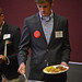 Shelton Leadership Forum attendee wears an Andy Albright quote button as he gets his lunch.