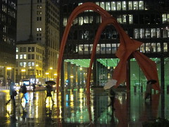 This Floating World (rwchicago) Tags: chicago winter rain evening rushhour downtown urban loop street streets alexandercalder flamingo umbrella