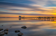 Evening Light (Stuart Schaefer Photography) Tags: landscape sunset pier water reflections outdoor longexposure florida dock travel gulfbreeze bluehour outdoors seascape rocks boat cloudscape clouds sky sea