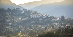 Little houses on the hillside. (AlbOst) Tags: houses italy sunlight mountains pastel churches eu hazy hillside eveninglight smallhouses littlehouses emilaromagna italianlandscapes tornolo