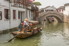 going under (stevefge) Tags: china shanghai zhujiaujiau watertown canals bridges boats boatman arch people men candid street reflectyourworld