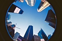 Times Square from Below (timnutt) Tags: timessquare sky architecture buildings skyscrapers crane blue analogue film 35mm lomo lomography newyork nyc fisheye surreal