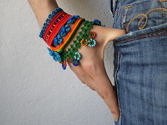 Freeform crochet cuff bracelet with orange, red, turquoise blue, indigo and green beaded flowers by irregularexpressions (irregular expressions) Tags: flowers flower art thread beads colorful handmade unique limegreen crochet expressions indigo seed jewelry jewellery cotton button bracelet statement wearableart etsy cuff wearable fiber crocheted beaded fibers beadwork irregular crimsonred freeform flowery delica cuffbracelet royalblue colorfulflowers freeformcrochet crochetflower turquoiseblue crochetbracelet crochetlace beadedbracelet beadedcuff irregularexpressions crochetcuff fiberbracelet colorfulbracelet statementbracelet statementjewelry