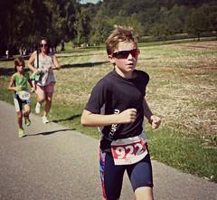 Running with shades 2 (Cavabienmerci) Tags: boy sports boys sport race children schweiz switzerland kid  child suisse running run course runners pied runner triathlon laufen triathlete lufer lauf 2015 uster