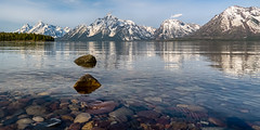 Jackson Lake - Explore (Marvin Bredel) Tags: lake mountains reflection water rocks explore wyoming colterbay grandtetonnationalpark jacksonlake marvinbredel