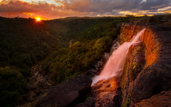 Warm embrace (Explored) (Sapna Reddy Photography) Tags: cheerapunji sohra meghalaya northeastindia india landscape waterfall sunset nature flow glow canyon water mountain drama colors red twilight warmth