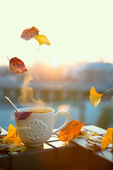 Autumn is a second spring when every leaf is a flower. -Albert Camus (Yuri Figuenick) Tags: explore morning coffee cup steam sunrise dawn lensflare ginko leaves fallenleaves fall autumn stilllife balcony light backlit focus bokeh levitation float magic dreamy sky