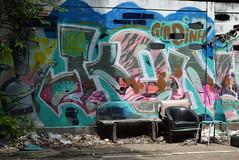 In the Limelight - Phayathai, Bangkok (jcbkk1956) Tags: ratchathewi bangkok thailand phayathai graffiti wall chair grot rubbish nikon nikkor 1855mmf3556dx bench seat world trekker worldtrekker