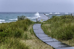 Standing in the rain and catching the breaking waves on Lake Michigan (TAC.Photography) Tags: breakwall crashingwaves tacphotography frankfortmichigan lakemichigan stormyseas