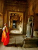 Meet the Parents (Eye of Brice Retailleau) Tags: icon effigy figure statue beauty colourful colours composition scenery scenic urban street streetphotography sculpture ambiance door castle people monk robe orange asia cambodia cambodge angkor wat corridor perspective angle indoor