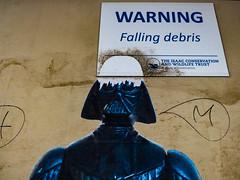 Warning Falling Debris (Steve Taylor (Photography)) Tags: warning fallingdebris art graffiti sign pasteup wheatup wheatpaste blue brown plywood wood newzealand nz southisland canterbury christchurch cbd city perspective starwars helmet darthvader