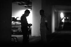 I've got your number too ! (N A Y E E M) Tags: policeman scout latenight carpark light cellphone gun moment driveway radissonblu hotel chittagong bangladesh sooc raw unedited untouched unposed availablelight bokeh windshield