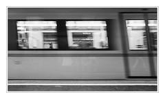passing by (macplatti) Tags: wien street travel urban bw underground subway austria blackwhite traffic stripes streetphotography ubahn sw noise velocity korn streifen aut rauschen geschwindigkeit vorarlberg verkehrsmittel digitalnoise publictraffic untertag