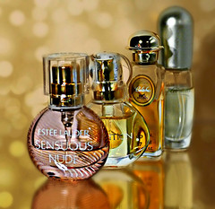 Mini Fragrances. (Through Serena's Lens) Tags: mm macromondays miniature mini bottle perfume fragrant bokeh stilllife reflection tabletop inarow macro