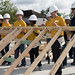 Sailors lift a structural wall during a Habitat for Humanity build for Houston Navy Week.