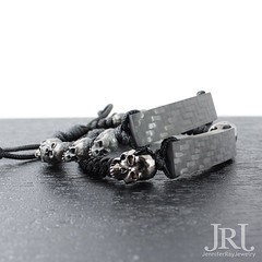 Matte carbon fiber with skulls bracelets. Custom handcrafted luxury wrist candy. Available now on http://bit.ly/2gmXiVx  Worldwide FedEx Shipping  #jenniferrayjewelry #car (JenniferRay.com) Tags: instagram carbon fiber jewelry exclusive jrj jennifer ray paracord custom