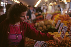 Retro image of woman shopping in Pike Place market looking at produce Seattle Washington USA 1980's (Jim Corwin's PhotoStream) Tags: nw pacificnorthwest pikeplacemarket seattle attractions city destinations display downtown eatery openmarket displays booths foodbooths fooddisplayed fruits historicalsite history horizontal landmark woman women lady northwest openairmarket photography placestosee retail shop shopping sightseeing store stores streetvendors tourism tourists travel trendy unique urbanscene vendors