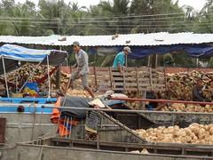 Smile on the side (program monkey) Tags: vietnam mekong river delta cargo boat ben tre tra vinh smile coconut factory processing