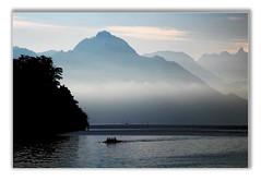 Ruderboot 1-1 (GhostOfDorian) Tags: morning alps water silhouette fog canon skulls schweiz switzerland see boat wasser nebel luzern berge alpen lucerne morgen vierwaldstttersee dunst rudern lakelucerne rigi rowingboat ruderboot ruderer vierer sigmazoom eos600d doppelviererohnesteuermann