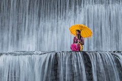 Balinese girl with cerimonial umbrella, Waterfall, Bali, Indonesia (Joel Santos - Photography) Tags: bali woman water girl umbrella indonesia flow waterfall time traditional