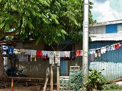 Domestic and Public Mix (mikecogh) Tags: bench mix poor electricity hanging nets telegraphpole meters washing corrugatediron portvila