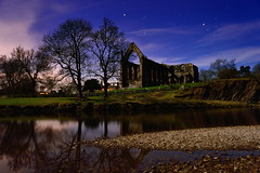A night at the Abbey (images@twiston) Tags: anightattheabbey moonlitabbey boltonabbey ruins augustinian priory parish churchofsaintmaryandsaintcuthbert churchofstmaryandstcuthbert bolton abbey monastery moonlight moonlit night time nighttime yorkshiredalesnationalpark dissolutionofthemonasteries 1154 devonshire estate northyorkshire stone national park yorkshire sky grass tree trees branch branches landscape dales architecture stars nightsky longexposure afterdark nightshot lowlight illuminated silhouettes silhouette silhouetted imagestwiston blue green my365year abbeybynight river wharfe reflections orion