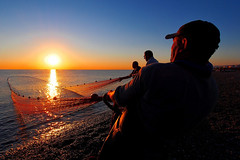 Pulling the life.. (Lucio Busa) Tags: sea seascape mediterranean fisherman fishing calabria schiavonea mare spiaggia reti luce lights sunset sunrise alba pescatori